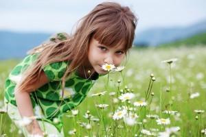 bigstock_Cute_child_girl_at_camomile_fi_21891833