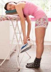 woman-asleep-on-ironing-board