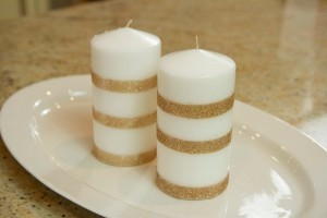 white-candles-decorated-with-gold-glitter