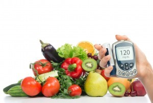Diabetes concept glucose meter in hand and healthy organic food fruits and vegetables organic green apple, egg plant, orange, tomatoes, cucumbers, parsley, kiwi, grapefruit, salad, peach, cherries on a white background