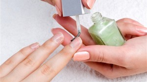 applying manicure: moisturizing the nails and skin around nails